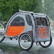 a pet stroller or trailer can keep your dog or puppy dry and protected in wet rainy weather