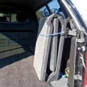 a foldable dog ramp can be stored inside the boot of a car